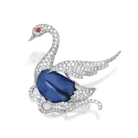 a swan brooch by michael youssoufian