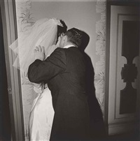 groom kissing his bride, n.y.c by diane arbus