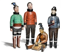 a group of inuit figures depicting an catechist, pregnant woman, man and seated woman with an ulo in traditional costumes (4 works, various heights) by johan johansen kreutzmann