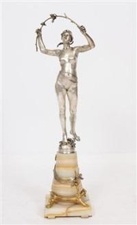 une femme dénudée sur la pointe des pieds en extension tenant une brindille dans ses deux mains en arc de cercle by eugène marioton