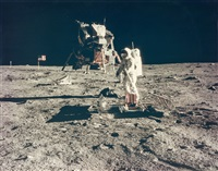 buzz aldrin sets up the passive seismic experiment by neil armstrong