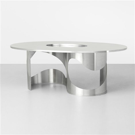 important saturn dining table by maria pergay