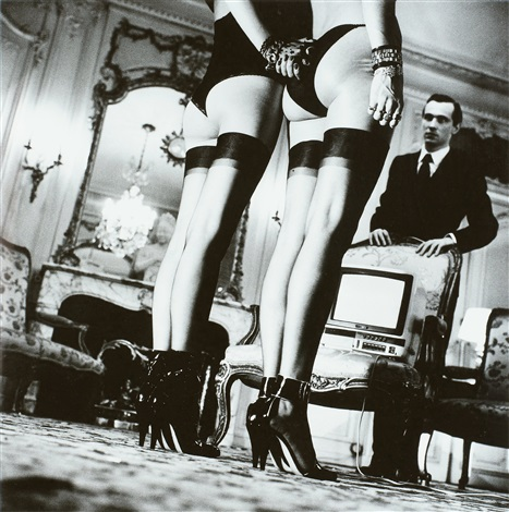 two pairs of legs in black stockings paris by helmut newton