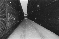 snow in alley by mark cohen