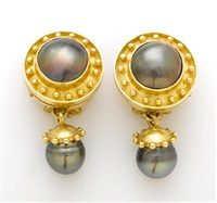 a pair of day/night earrings by elizabeth locke