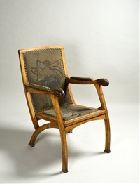 an armchair with a painting by ota janecek