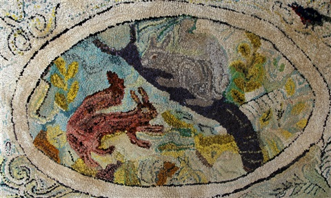a rag rug of two squirrels within an oval the border decorated with birds and foliage by winifred nicholson