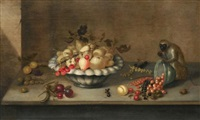 a still life of pears in a bowl and scattered gooseberries, cherries, peas, strawberries, redcurrants, blackcurrants and hazelnuts on a stone ledge with a chained monkey by johannes bouman