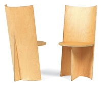 a pair of chairs by beat frank
