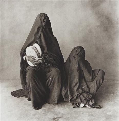 Two Women In Black With Bread Morocco By Irving Penn