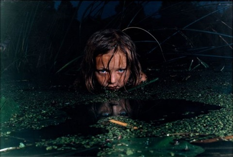 girl in a swamp fear series by oleg kulik