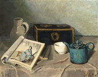 a still life with a blue teapot, books and a jug by marie van regteren altena