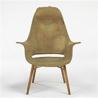 organic design high back armchair by eero saarinen and charles eames
