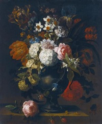 a still life of guelder roses, tulips, daffodils, an iris, a peony and other flowers in a vase on a stone ledge by gaspar pieter verbruggen the younger