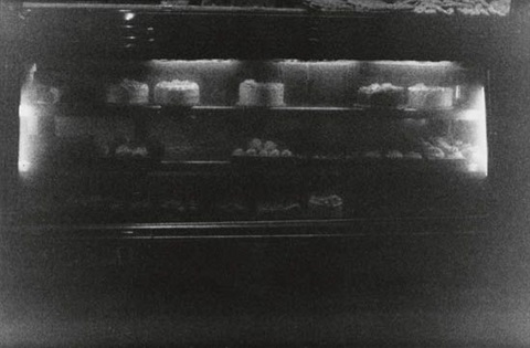cakes in window by zoe leonard
