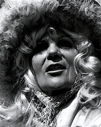 untitled - woman with blond hair and feathered hat by leon levinstein