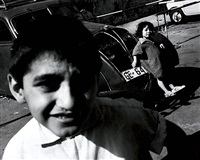 untitled - young boy in foreground, young girl in back by leon levinstein