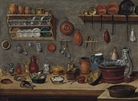 a loaf of bread, jugs, vegetables in a pot and copper pans on a table, with plates, pans and other utensils on the wall by pieter jacob horemans