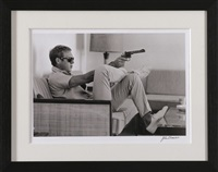 steve mcqueen aiming a pistol in his living room, palm springs by john dominis