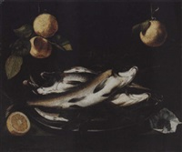still life of fish on a pewter plate, together with peppercorns and a sliced lemon, upon a stone ledge, with oranges hanging above by alessandro de loarte