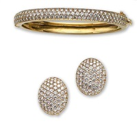 a bangle bracelet and pair of earrings (set of 2) by kurt wayne