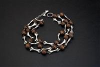 dog bone necklace by hubert harmon