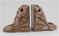 serre-livres au motif art nouveau (pair) by arthur craco