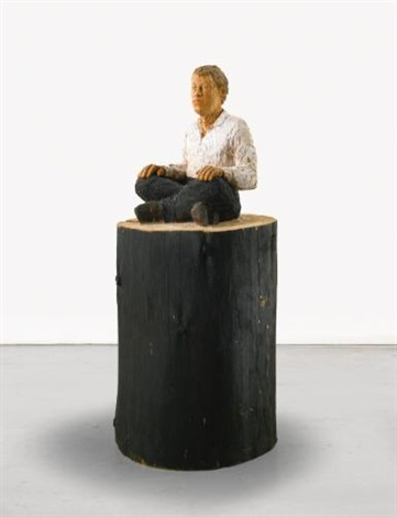 man sitting by stephan balkenhol
