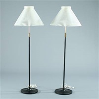 a pair of telescope standard lamps (designed by aage petersen and tage klint) by le klint
