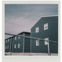new houses behind chain link fence, jersey city, n.y. by dan graham