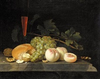 still life with peaches, grapes, walnuts, bread, a half-filled flute, vine leaves and a knife handle on a stone ledge by gillis jacobz van hulsdonck