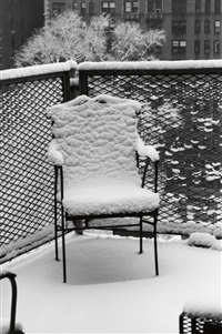snow covered chair by andré kertész