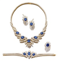 parure comprising a necklace, bracelet, a pair of ear clips, and a ring (set of 4) by fred