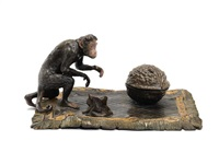 inkwell depicting a chimpanzee with a nut by nam greb