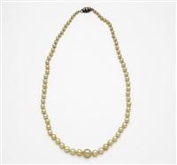 a strand necklace by mikimoto