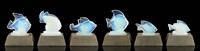 suite de six veilleuses sur pied de métal argenté supportant six poissons en verre translucide (set of 6) by marius-ernest sabino