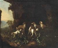 hounds in a rocky landscape, a horseman beyond by adriaen beeldemaker