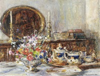 a still life of assorted flowers and a tea service in a dining room interior by rowland henry hill