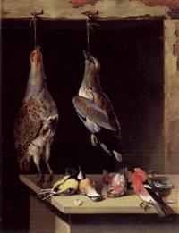jagdstilleben mit erlegten vögeln, die vom fensterbalken hängen und auf dem tisch liegen by lambert van bokkelen