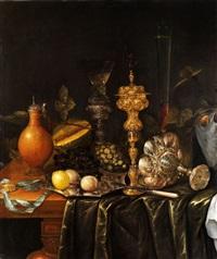 stilleben mit prunkpokalen, gläsern, kanne, zitronen sowie trauben auf einer silberschale by jan snets