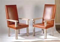 paire de grands fauteuils by jacques adnet