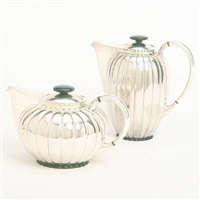 a melon shaped coffee pot and tea pot by a. f. rasmussen