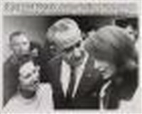 president and mrs. lyndon b. johnson console jackie kennedy after being sworn in by cecil, capt. stoughton