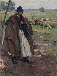 stehender schäfer mit seiner herde im sonnigen licht by miklos banovszky