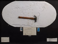 negative relief globe for causing earthquakes (with hammer) by vitaly komar