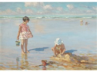 building sandcastles on the beach by charles garabed atamian