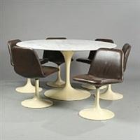 a circular table and six swivel chairs (set of 7) by eero saarinen