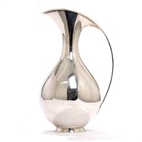 pitcher with curving handle on round base by kay fisker