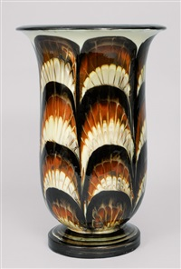 a big vase with stylised leave decoration by kähler pottery (co.)