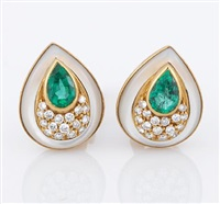 a pair of earrings by fred